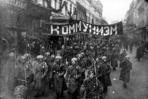 Armed_soldiers_carry_a_banner_reading_'Communism',_Nikolskaya_street,_Moscow,_October_1917
